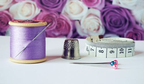 Sewing Thread, Thimble, and Measuring Tape